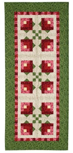 Free Quilt Pattern: Rosebud Jen Daly--Careful fabric selection and color placement form these sweet little rosebuds. This free quilt pattern was designed and made by Jen Daly and is made with easy blocks! Download the free quilt pattern.