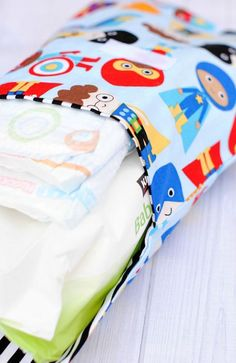 You can make a customized diapers + wipes holder by following this DIY sewing tutorial.