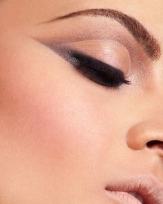 Make-up; natural looking but dramatic eyes, bronze shadow, black liner
