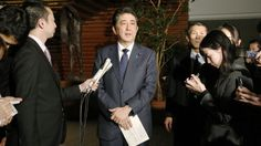 """Japanese Prime Minister Shinzo Abe (centre) speaks to the press at his official residence on Monday, after a telephone conversation with South Korean President Park Geun-Hye. Abe said an agreement between Japan and South Korea on the issue of wartime sex slaves heralds a """"new era"""" in relations between the two countries."""