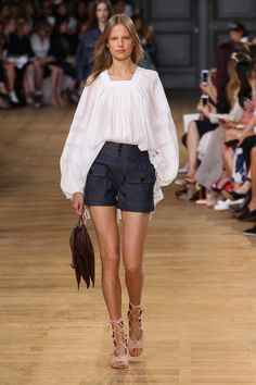 Chloé Spring-Summer 2015 #SS15 #PFW   Silk Blouse Embellished with Pierced Rings and Cotton Incrustations, Patched Pockets Short in Raw Denim, Faye Clutch with Leather Strap in Croc Embossed Vegetal Leather, Foster 5cm Wedge Strappy Ankle Boot in Suede Kidskin