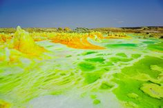 Sulfuric acid pools in Dallol in the Danakil depression of Ethiopia. The average annual temperature is 94+ degrees fahrenheit. Dallol is one of the areas in the world with the highest concentration of permanently active geysers, and the only volcano in the world on land, that has a crater below sea level. Wikipedia
