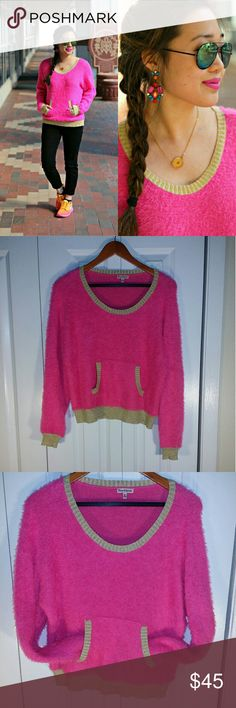 Juicy Couture Fuzzy Hot Pink Sweater !!!! Blogger Choice! PRE-OWNED EXCELLENT CONDITION Juicy Couture Hot Pink Fuzzy Sweater.  GOLD Trim on the collar, cuffs,  and bottom.  Kangroo pocket in front in gold as well. Super Soft Extra Fuzzy and OH SO CHIC!    Size Medium  60% Cotton  40% Nylon   (Minor fraying of the trim due to the material it's made of but not really noticeable). Juicy Couture Tops