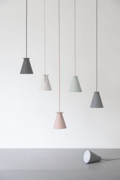 Bollard — Shane Schneck for Menu . Hang it from the ceiling as a pendant, angle it as spotlight, place casually on shelf or use to beam light up by placing on its foot.
