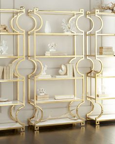 """Handcrafted etagere sold individually. Tubular steel frame with polished-brass finish. Six wood shelves with lacquered finish. Adjustable glides. Comes with anti-tipping kit. 38""""W x 16""""D x 84""""T. Impor"""