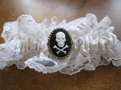 Ivory Lace Pirate Wedding Garter (Gold Medallion). $18.00, via Etsy. Keywords: #weddings #jevelweddingplanning Follow Us: www.jevelweddingplanning.com  www.facebook.com/jevelweddingplanning/
