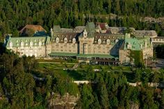 This hotel is majestically perched on a cliff between the St. Lawrence River and the Laurentian Mountains, in the heart of Charlevoix. The Places Youll Go, Great Places, Places Ive Been, Places To Visit, Baie St Paul, Malbaie, Charlevoix, O Canada, Villas