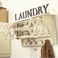 Bathroom/Laundry Area: install a wall shelf, attach a foldable drying rack. Also, to maximize the space, install hooks for coats, etc.
