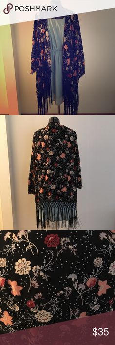 Floral Print Crepe Fringe Kimono Amazing floral print fringe kimono! Perfect for layering over everything! Sleeves can be rolled up and button near the elbow or worn full length. Perfect condition only worn once. Torrid size 1 torrid Tops