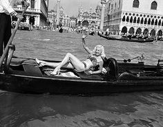 Diana Dors maxin' and relaxin' in a gondola for the Venice film festival of 1955 wearing her notorious mink bikini - glamour.