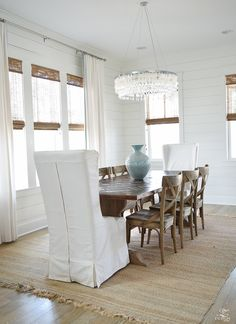 Coastal Dining Room farmhouse x back chairs capiz chandelier beach decor dining room white slipcovered dining chairs natural woven shades-2