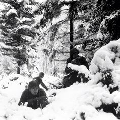 75th Infantry Division soldiers laying in the snow during the Battle of the Bulge. Ardenne forest, Belgium, December, 1944