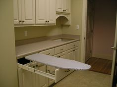 Hideaway/ ironing board/ laundry room/ cabinets/ storage/ painted/ white