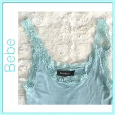 Bebe Lace Amazing color, soft fabric ribbed tank with lace trim!Sexy piece for the summer!Excellent condition, worn once.... bebe Tops