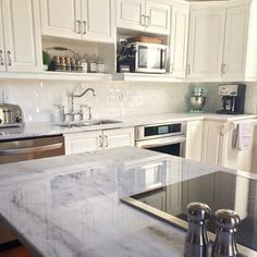 Countertops are finally done! White shadow storm #quartzite #countertops