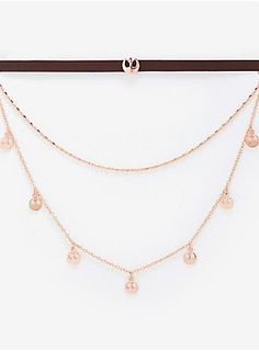 You've joined the Rebellion. Show that off with this trendy layered necklace. This rose gold necklace features a brown faux-leather choker with a rose gold Rebel emblem charm, a dangling chain, and a chain with repeated Rebel emblem charms.   Nickel free  Imperial