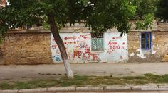 Wall with graffiti at Odessa's Moldavanka district.