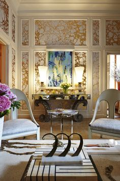 I LOVE the combination of wallpaper and molding!  That is so unique......and expensive I am sure!
