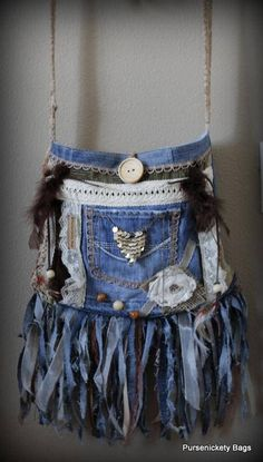 Unique OOAK denim fringe handbag made from recycled denim jeans and other new and recycled materials. Fringe made of fabric pieces, feathers, lace and beads. Embellished with jewelry trinkets, beads, lace trim and a fabric flower.. Denim pocket and wood button with a string tie is