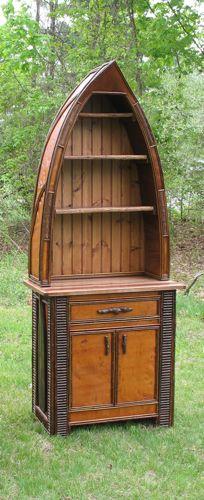 Rustic canoe cabinet.