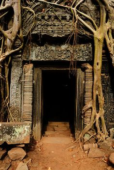 Angkor .. At the site of a ruined monastery, he whispers for some time into a hollow in a ruined wall, before plugging the hollow with mud....