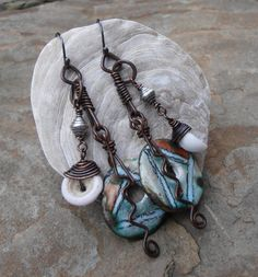 Ceramic Discs(ScorchedEarthEtsy), Delicious Vintage Shells, Sterling Silver Beads, Oxidized Copper Wire were used in the assemblage of these Truly