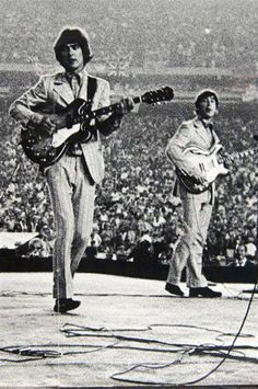 George Harrison and John Lennon, Shea Stadium, 1966.