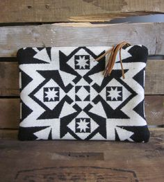 Black & White Geometric Wool Clutch by Mercy Grey Design Co. on Scoutmob Shoppe. Enjoy all the fringe benefits this versatile wool and leather purse has to offer.
