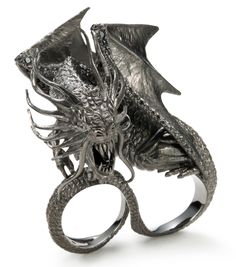 "Jabberwocky ring inspired by Tim Burton's ""Alice in Wonderland"" movie. A literary classic, the novel inspired both a Disney film directed by Tim Burton, and H.Stern who, in 2010, created an extraordinary jewelry collection of artistically sculpted rings in enameled gold and diamonds. This outstanding limited-edition collection is now a part of our history."