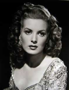 the beautiful Maureen O'Hara/••••She was one of my favorites, mostly because she frequently played opposite John Wayne, who was Daddy's favorite & mine by association. She & Patricia Neal were the only tall actresses around about then so one of them usually was cast w/Wayne. Her life was not always happy & John Ford, who frequently directed Wayne films, was a rattlesnake to work with, but she was a trooper!