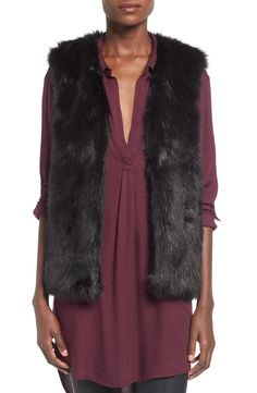 Finish any outfit in warmth and style with this sassy faux-fur vest.