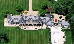 The lavish home of Jerry and Jessica Seinfeld is no laughing matter! They bought this enormous East Hampton, N.Y., estate for a reported 32 million from rocker Billy Joel. The home includes a 22-car garage and a baseball diamond, according to ABC News. OK! Magazine named it the #1 celebrity party house.