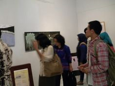 ...guests examined the paintings which are the vizual art of my poems..