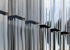 This data storage centre in Basel by FFBK Architects has a ridged shell of both perforated and solid steel panels