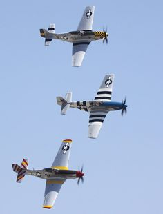 Pair of North American P-51D Mustangs with a P-51B centre, Chino 2010 Airshow