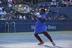 Community Day at the Open   September 8, 2016 - A fan plays with an oversized tennis racquet at the farewell ceremony at Louis Armstrong Stadium during Community Day at the 2016 US Open at the USTA Billie Jean King National Tennis Center in Flushing, NY.