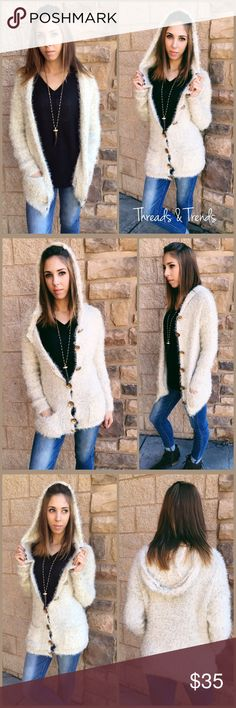 Mohair Hooded Cardigan Super soft mohair hooded cardigan sweater. Featuring 2 front pockets, gold tone buttons and shimmer of gold throughout. Made of a acrylic knit, spandex blend. Super stretchy. Size S/M, M/L, L/XL Threads & Trends Sweaters Cardigans