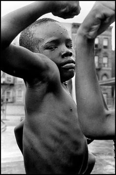 A child flexes for the camera in Harlem in 1963. (Photo: Leonard Freed/The Estate of Leonard Freed — Magnum Photos (Brigitte Freed))