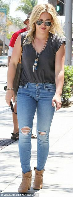 Dashing in denim: The 26-year-old actress highlighted her toned legs in skintight faded blue jeans slashed at the knees, while keeping it ca...