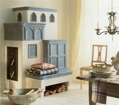 A Kachelofen: A wood stove made from ceramic tiles. Provides radient heat for up to 8 hours from 3 wooden logs. Wood Fired Oven, Stove Fireplace, Rocket Stoves, Traditional House, Home Furnishings, House Design, Interior Design, Furniture, Brunswick Street