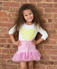 She'll feel like singing and doing the two-step in this pretty little skirt! It's easy to crochet for your favorite sweetie using plain and furry yarn for a fun style.