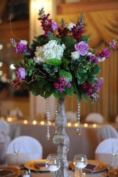 Magenta Wedding flowers tall center arrangement with plum, magenta, and white flowers. photo by www.saraackermann.com