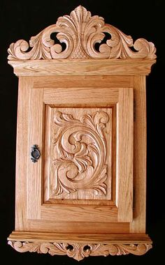Norwegian acanthus-style wood-carved wall cabinet