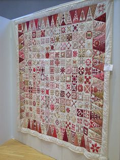 """""""Red Roses"""" by Manuela Miete Dancing Hands      """"Dear Jane Quilts"""" from the Quilt Group """"Dancing Hands"""" in Osnabrück at the 3. Main-Quiltfestival Aschaffenburg 2009, Bachsaal Christuskirche.    You can find a nice picture of block details in Hexe im Hollerbusch flickr file  www.flickr.com/photos/hexeimhollerbusch/3327259015/in/pho...    169 blocks original order different border"""