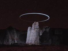 Reuben Wu Uses Drones to Create Halos of Light Above Mountaintops