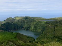 Western Islands Of The Azores: Flores - via The Tripper App 18.12.2014 | Legend (or History) has it that the island was named Flores because it was covered in flowers when Diogo de Teive discovered it in 1452. This 143 Km2 piece of land is the most western point of Europe, marked by a tiny islet off the coast west of Fajã Grande called Ilhéu do Monchique. Photo: Lagoa Funda and Lagoa Rasa