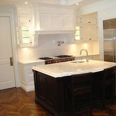 Gorgeous Two Tone Kitchen Design With Creamy White Cabinets Black Island Marble