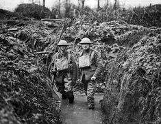 Two soldiers in flooded trench.