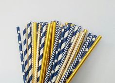 Set of assorted navy blue and gold paper straws. The assortment includes: ♥ navy blue chevron paper straws ♥ navy blue w/ white polka dots paper straws ♥ gold foil chevron paper straws ♥ navy blue swirl stripe paper straws ♥ gold foil paper straws  These paper straws would be perfect for a birthday party, baby shower, wedding, bridal shower or really any special event. These give an upgraded look to your drinks and work well in most drinks like cocktails and mixed drinks, sangria, juices...