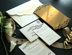 Elegant laser cut gold acrylic invitation for Heidi Mueller and DeMarco Murray